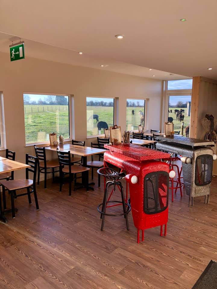 Internal view of cafe with two feature tables being tractor bonnets